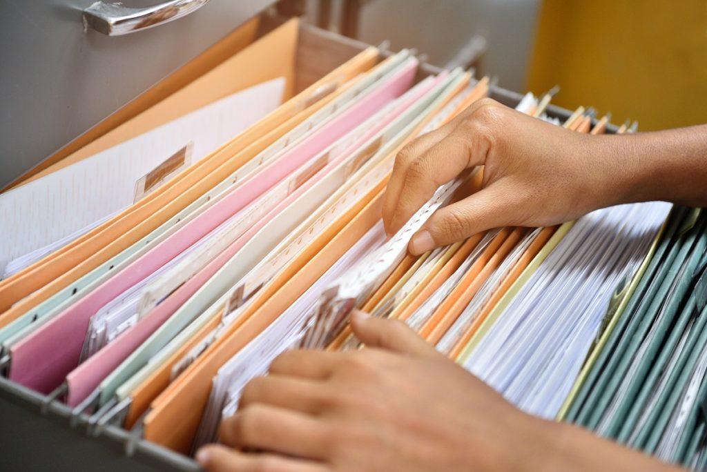 Folders in a file cabinet