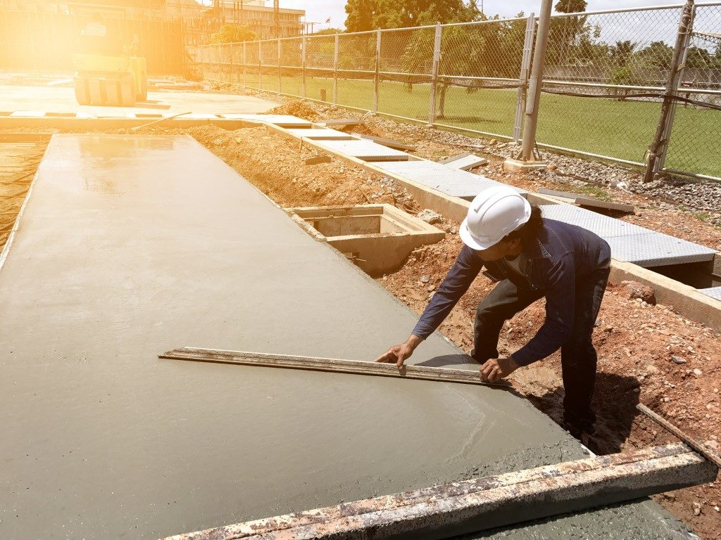 man smoothing out concrete