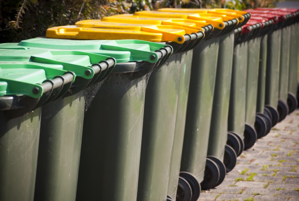 row of trash bins