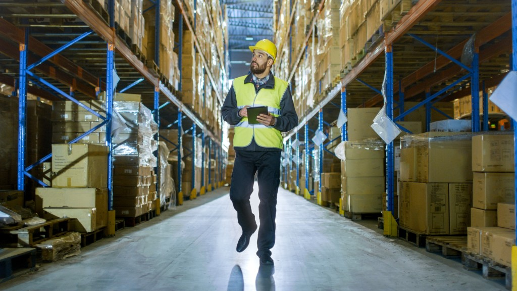 man inspecting the inside of a warehouse