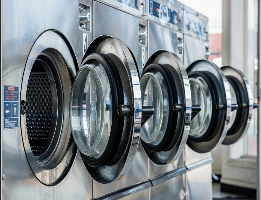 row of washing machines in the laundromat