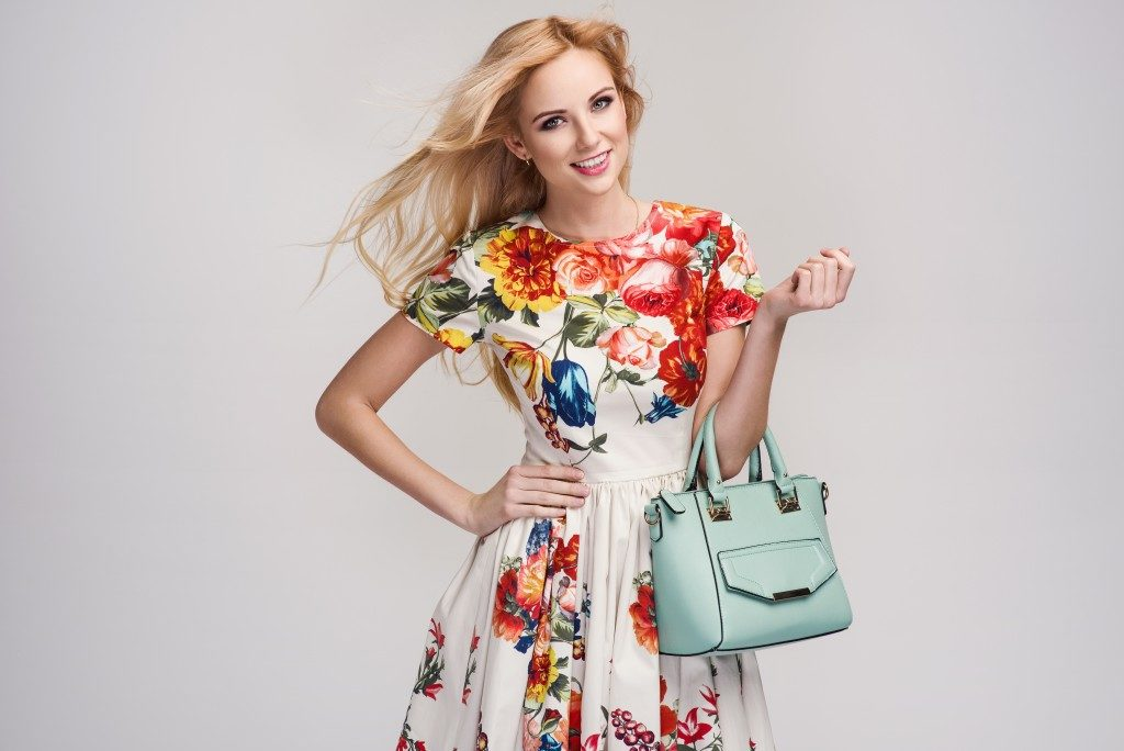 woman with floral dress and a handbag