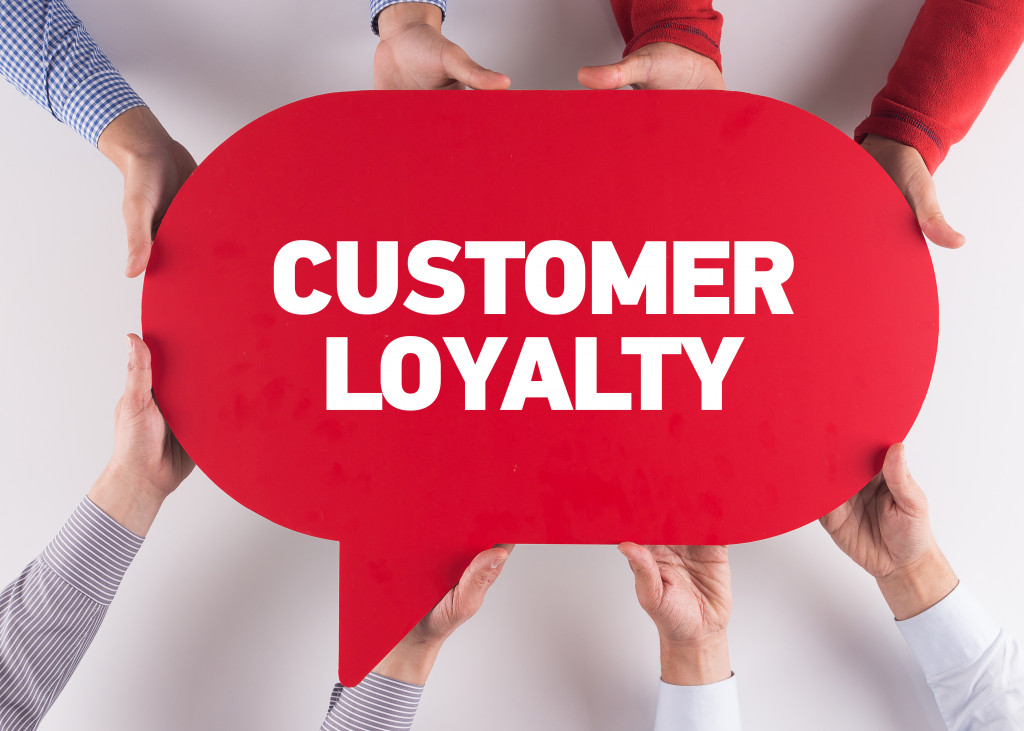 holding a customer loyalty speech bubble