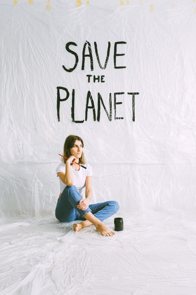 woman painting save the planet