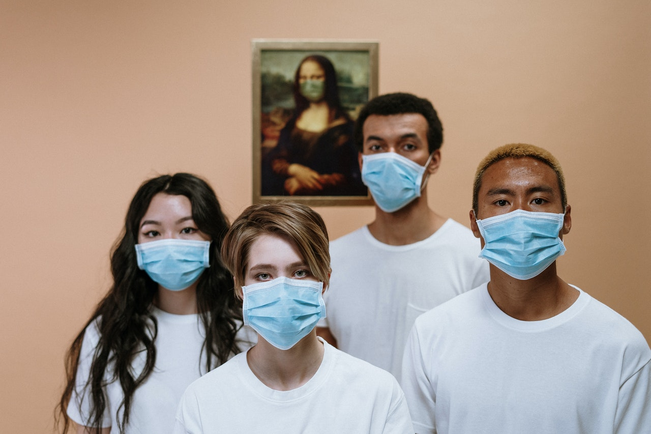 a group of friends wearing face masks
