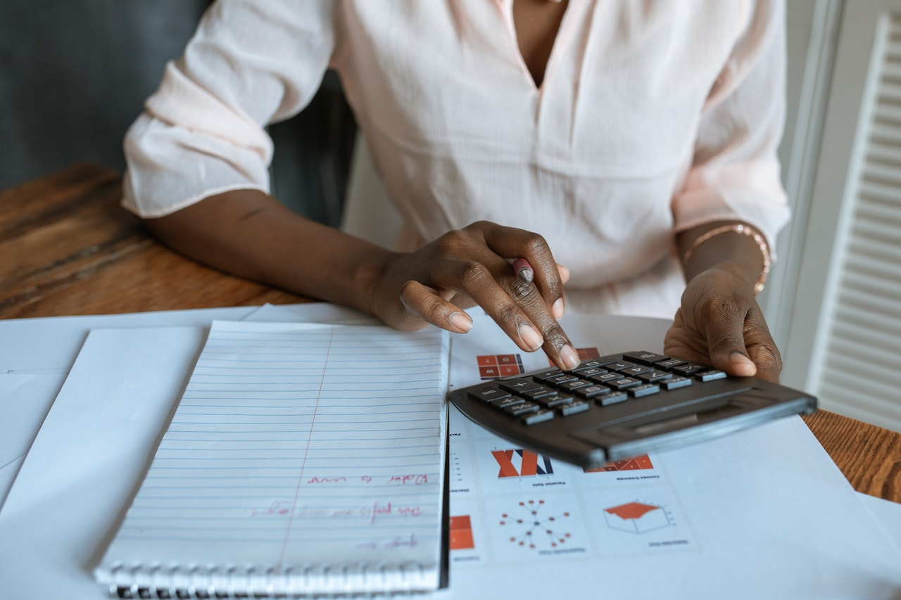woman calculating expenses