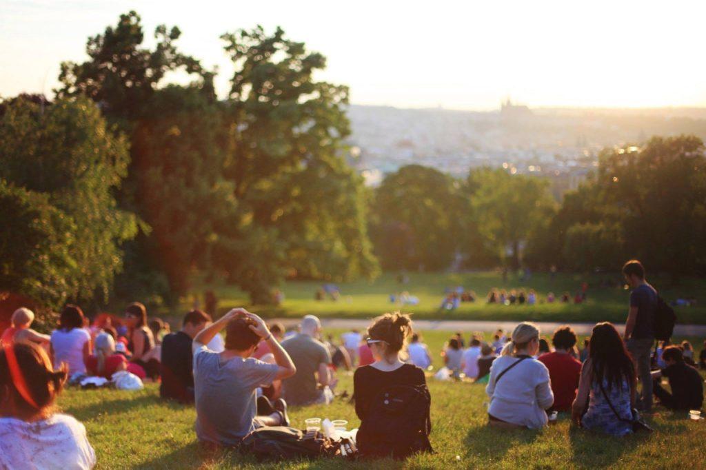 people sitting on a field