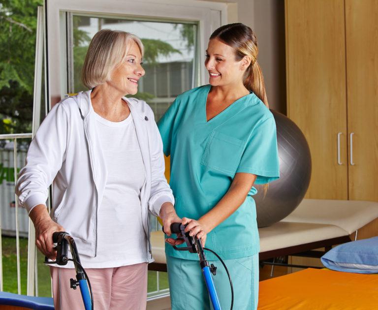 nurse helping elderly