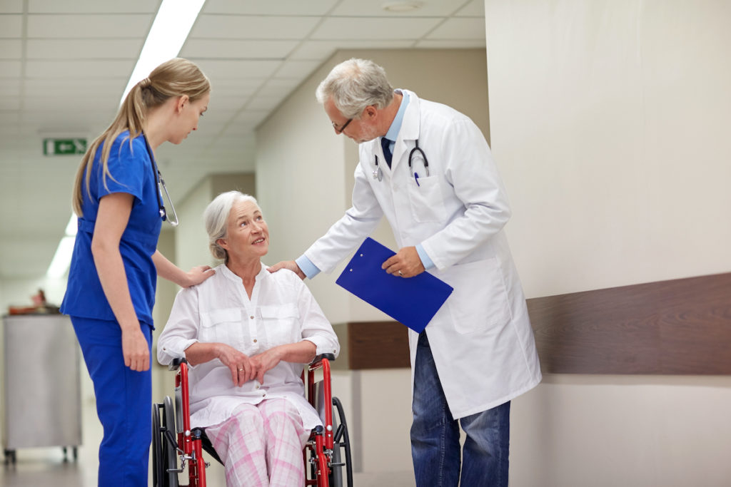 elderly with her doctor and nurse