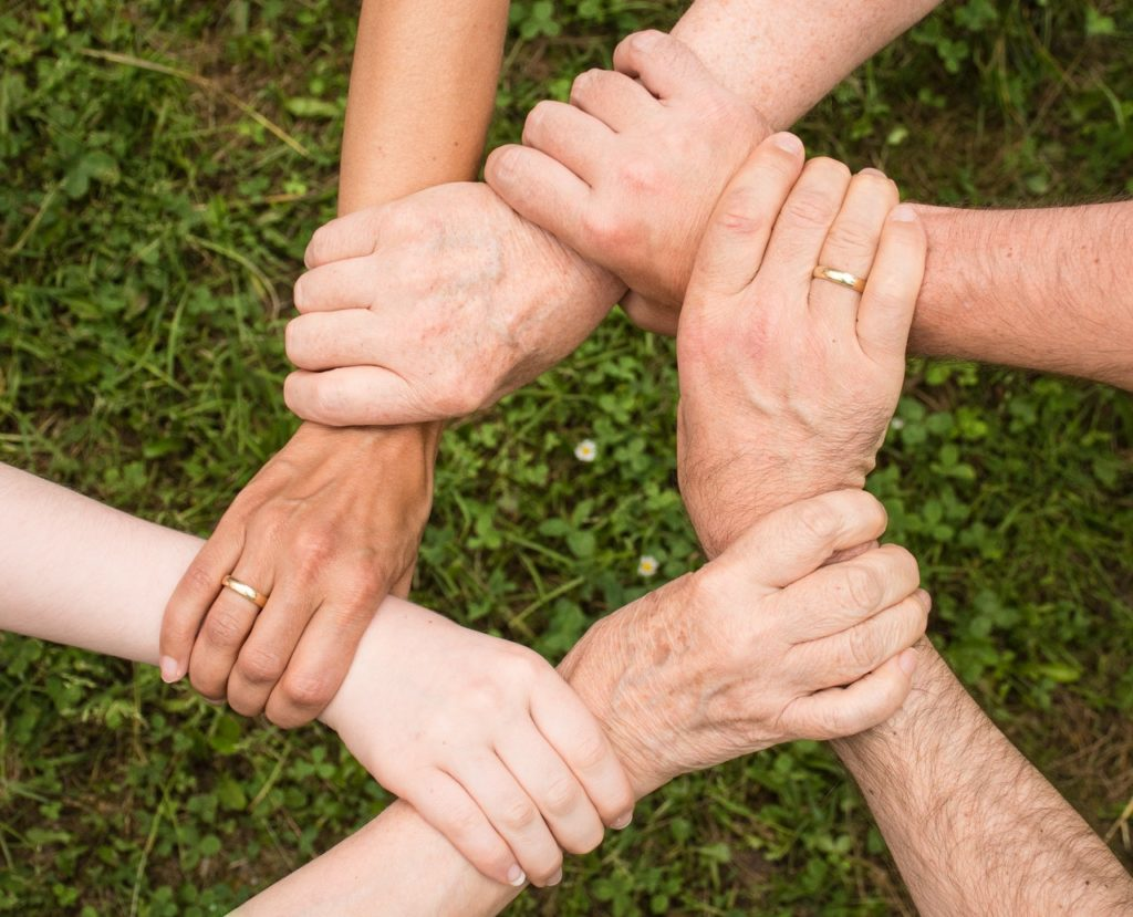helping hands within a community