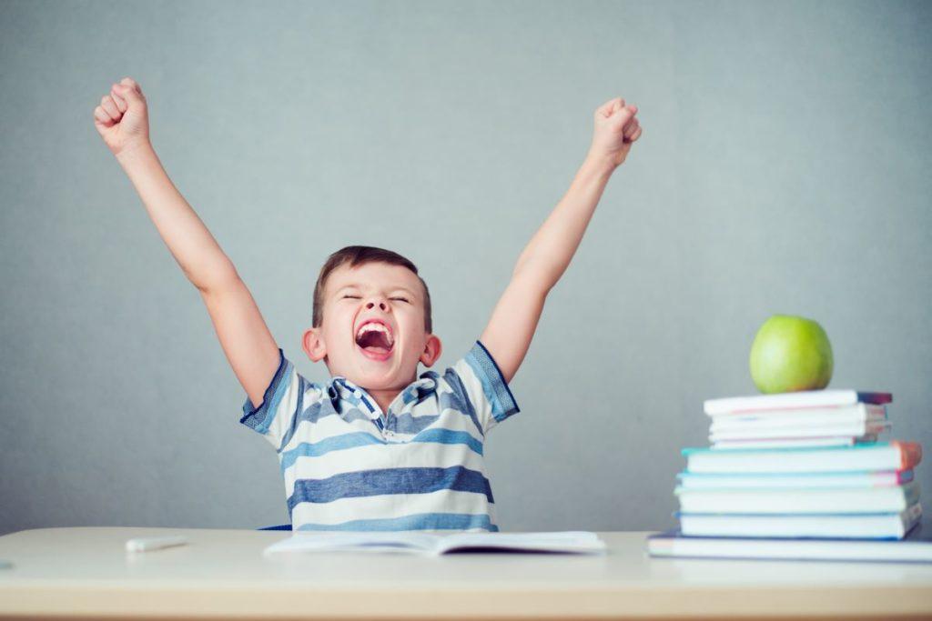 child cheering studying