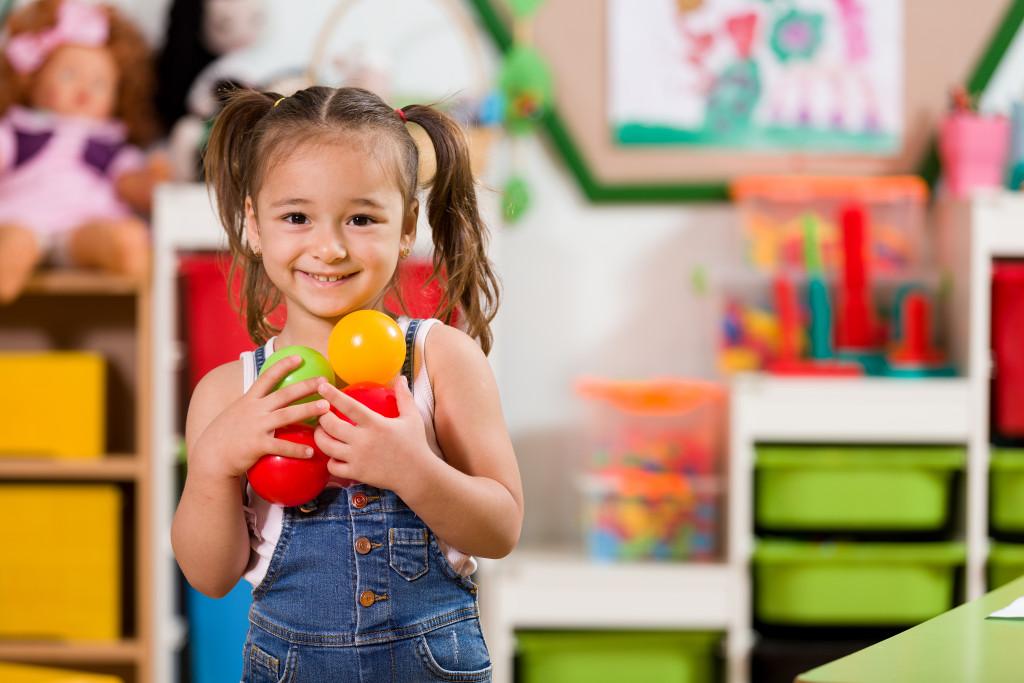 child holding toys