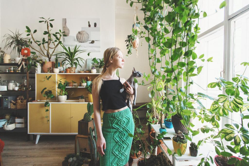 woman and her cat indoor garden