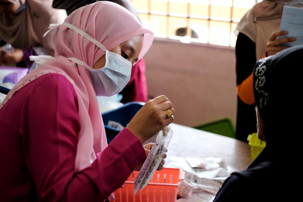 muslim woman packing plastic