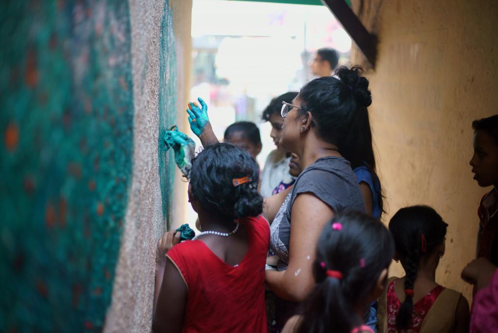woman teaching indigenous kids